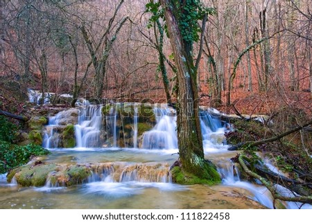 water cascades in a autumn forest - stock photo