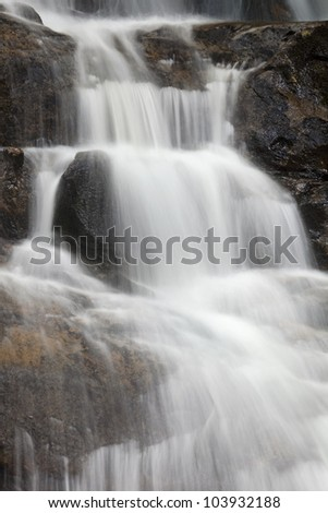 Water cascading down rocks - stock photo