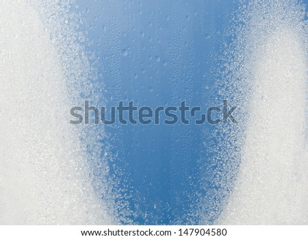 Water condensation on window frozen snow on glass, transparent glass of window in winter in contact with morning warm sunlight. Horizontal orientation, nobody. - stock photo
