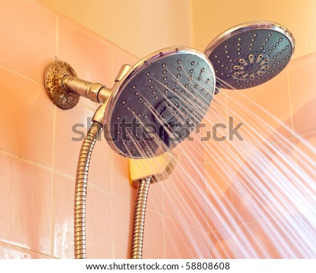 Water Conserving Shower Head Turned On - stock photo