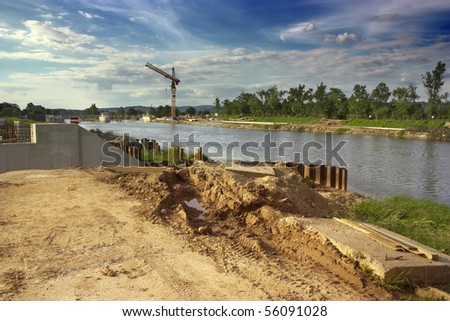 Water construction with tall crane - stock photo