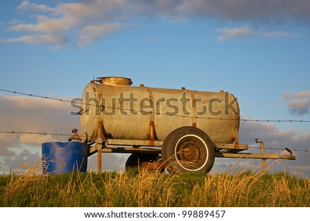Water container behind barbed wire on a Dutch dike