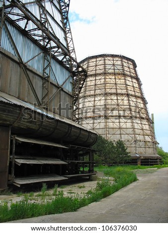 Water cooling tower at old electric power plant - stock photo