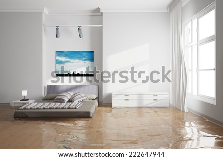 Water damage in bedroom after leak with wet bed - stock photo