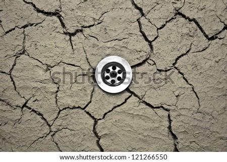 Water drain in dry soil - stock photo