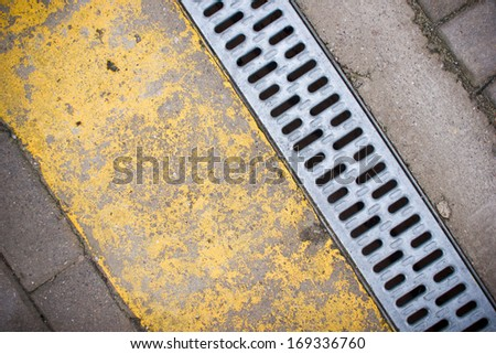 Water drain, metal part and old weathered yellow paint texture. - stock photo