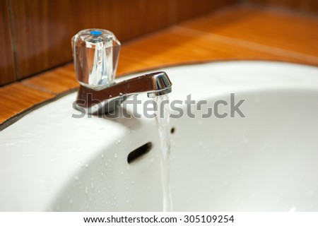 water draining in washbasin