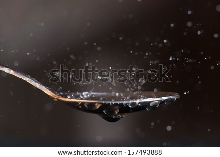 Water dripped on to the spoon - stock photo