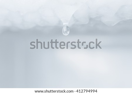 Water dripping from ice refrigerator freezer - stock photo