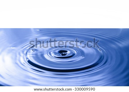 Water drop falling into water making a perfect droplet splash - stock photo