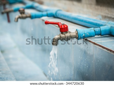 Water drop from faucet and water pipeline. Wash Basin ceramic tile. - stock photo