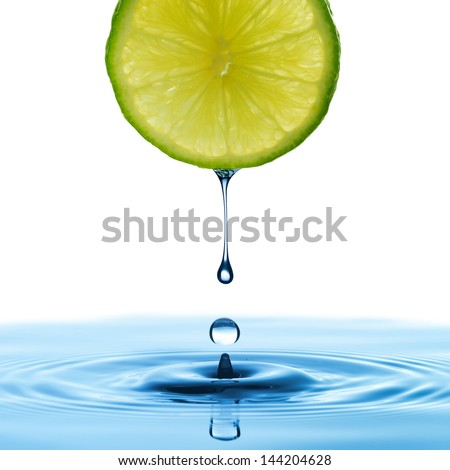 Water drop from slice of lemon - stock photo