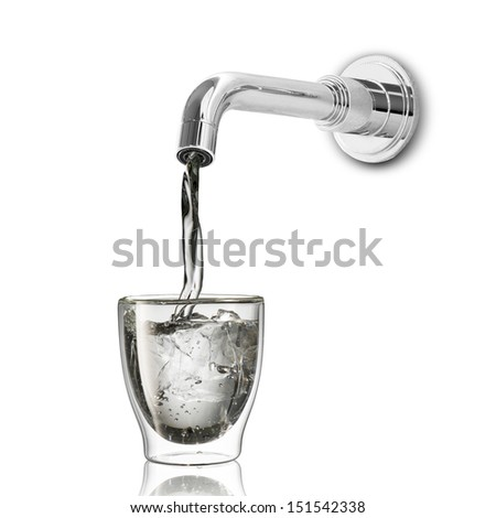 Water drop from water tap on to glass - stock photo