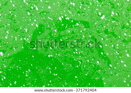 Water drop on green and white dot use for background - stock photo
