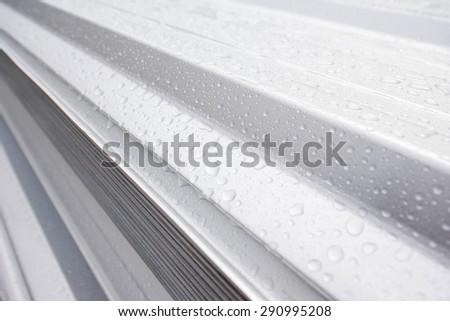 Water drop on metal sheet roof - stock photo