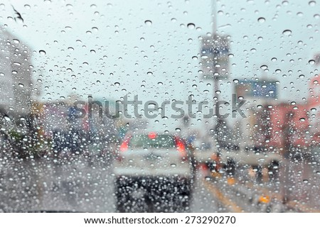 Water drop on traffic jam and electric light in the rain. - stock photo