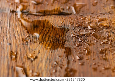 Water drop on wood - stock photo