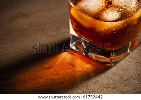 water droplets on a glass of whiskey - stock photo