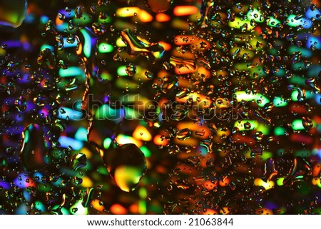 Water droplets on a multi-coloured background.