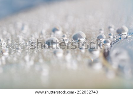 water droplets on compact disc or dvd - stock photo