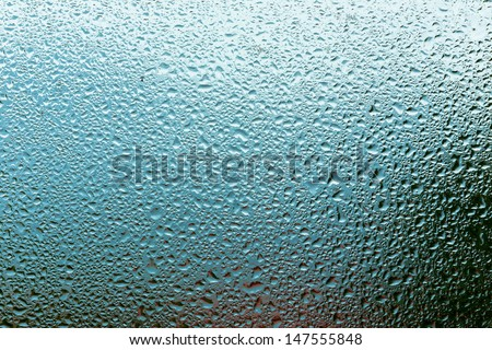 Water droplets on  glass - stock photo