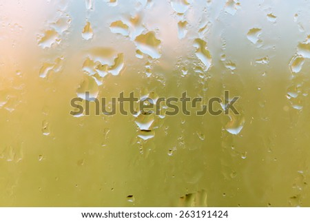 water droplets on glass as background - stock photo