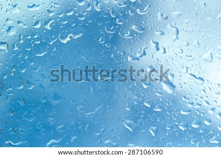 Water droplets on glass surface - stock photo