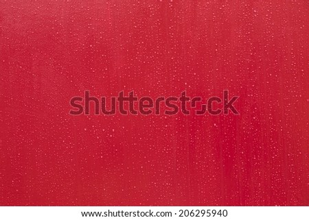 Water Droplets on red paint - stock photo