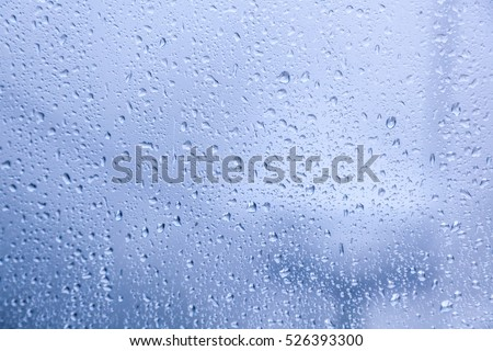 Water droplets on the glass. Abstract background and texture
