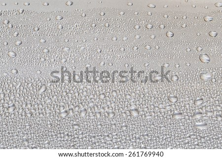 Water droplets on the surface of aluminum. - stock photo