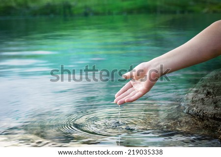 water dropping from a hand - stock photo