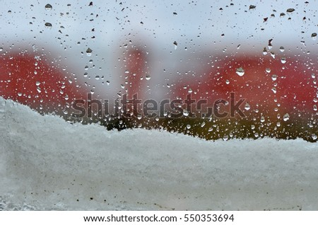 Water Drops And Snow At Window