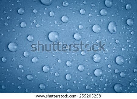 Water drops background. Toned. - stock photo