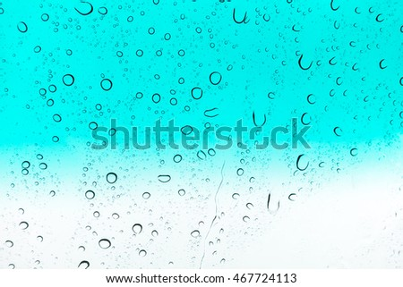 Water drops background. Water drops on glass window over blue sky.