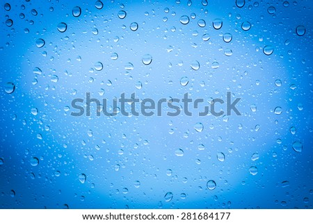 Water drops blue background surface
