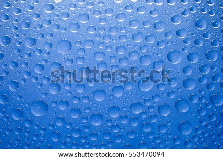 Water drops blue background. Water drops on glass background