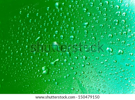 water drops close up-green vivid tones - stock photo