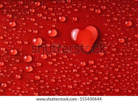 water drops forming a heart - stock photo