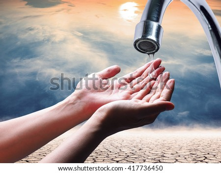 "water drops from faucet which lack of water,expression on ""EL nino"" climate effect - stock photo"