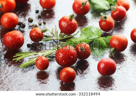 Water drops green and tomatoes - stock photo