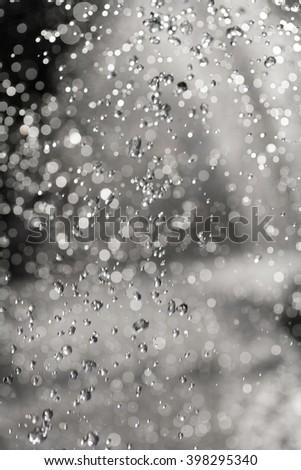 Water drops in the air seletive focus, defocused background - stock photo