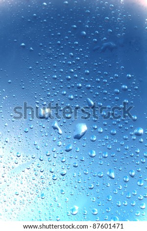 water drops macro blue tones - stock photo