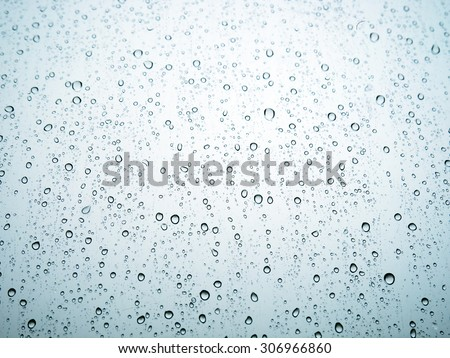 Water drops of rain on blue glass background - stock photo