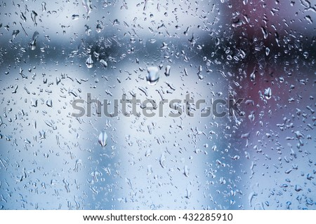 Water drops of rain on glass background after rain.