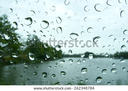 Water drops on a car glass. - stock photo