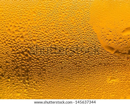 Water drops on a glass of cold beer - stock photo
