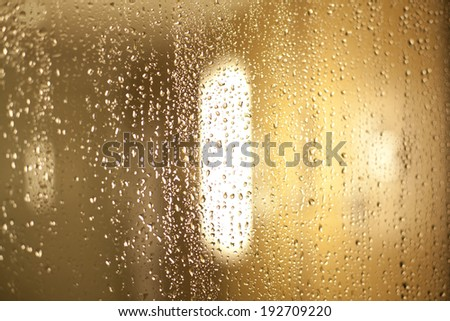 Water drops on a glass wall - stock photo