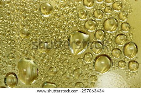 water drops on a golden background - stock photo