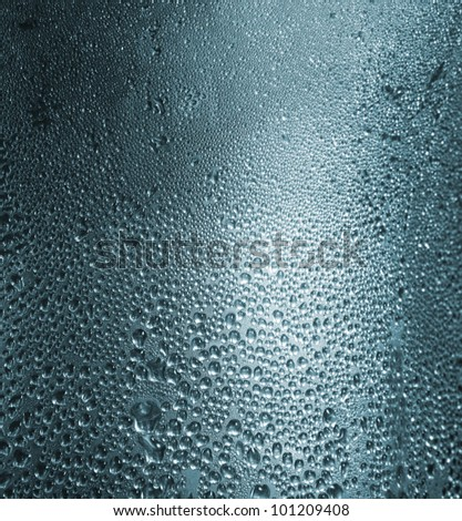 Water drops on a metallic background. Close up - stock photo