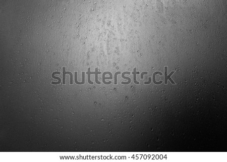 Water drops on a pane of glass. - stock photo